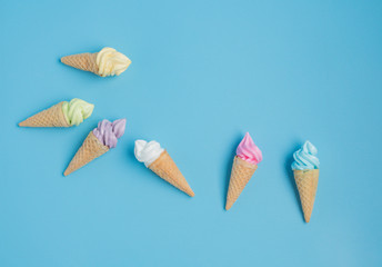 Colorful sweet ice cream cone isolated on blue pastel background ,holiday and relax concept