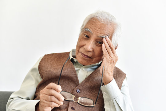Vision loss problems in senior, Eye diseases age related in old adult, Asian elderly man has a hypertension headache and blurred eyesight, Senior healthcare insurance concept.