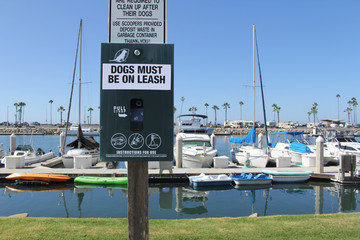 dogs must be on leash waste bags
