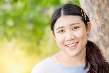Innocent beautiful cute girl teeth smiling  portly shape healthy Asian race outdoor green nature.