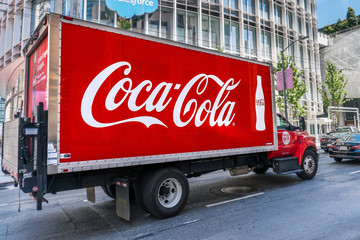 August 21, 2019 San Francisco / CA / USA - Coca Cola truck driving on a street in downtown San Francisco; SOMA District