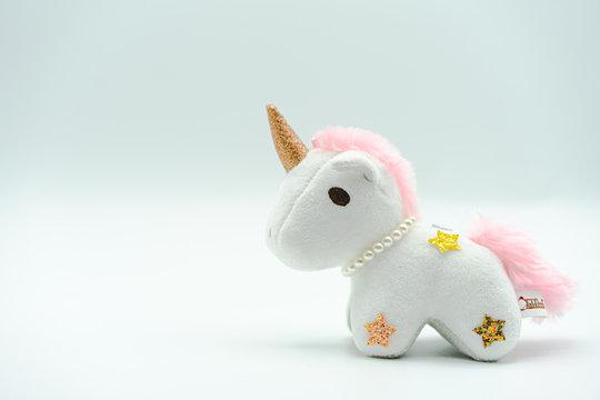 Fluffy unicorn plush kid toy isolated on white