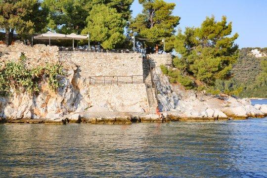Horizontal shot of Bourtzi Peninsula fort in Skiathos Greece during daytime
