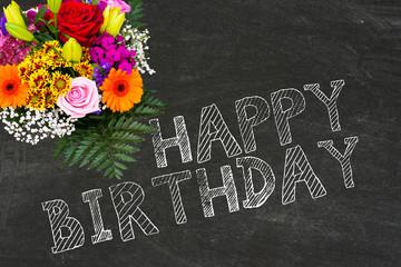 Ein Blumenstrauß und Glückwunsch zum Geburtstag