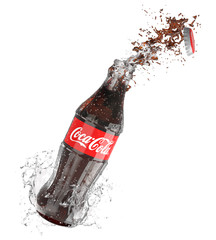 Coca-Cola bottle with splash isolated on white background Coca Cola is the most popular carbonated beverage sold worldwide