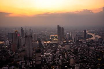 Fotobehang Amerikaanse Plekken Bangkok, Thailand - September 27 2019: Panoramic view of the Bangkok city Located at the top of King Power Mahanakhon Building with The sky and sun at sunrise nature background.