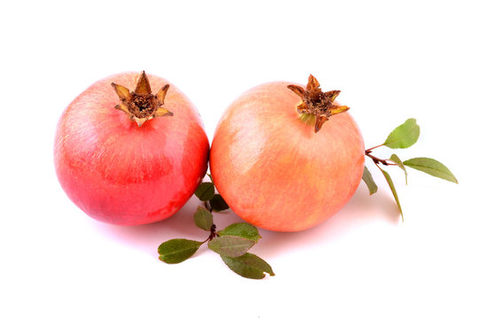 Pomegranate with leaves isolated on white background. Fresh tropical fruits, sweet and healthy.