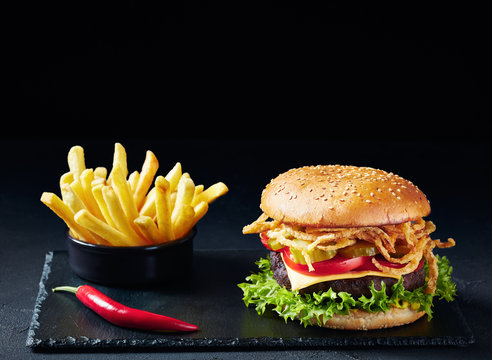 Cheeseburger with Beef Patty on a stone board