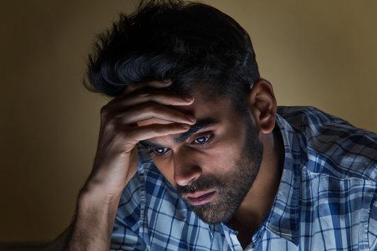 sad man thinking at home