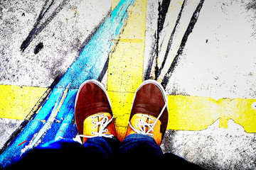 The feet that stand on the street are striped with street art. use effect Mix Hard in picture.