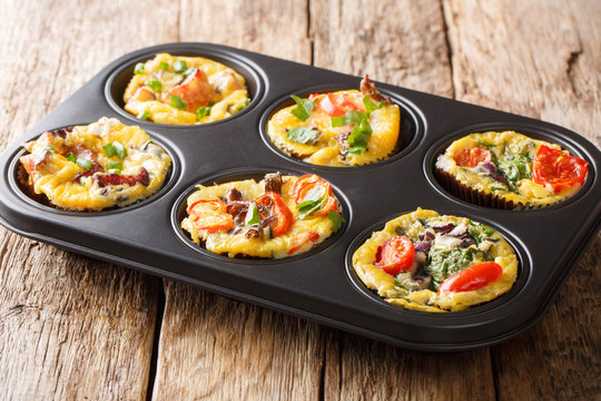 recipe for breakfastegg muffins with vegetables, cheese, bacon and mushrooms close-up in a baking dish. horizontal