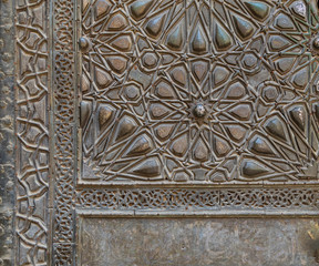 Ornaments of the bronze plate door of ancient historic mosque of Sultan Basque, Cairo, Egypt