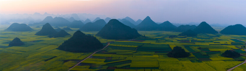 Panoramic view of small villages with Rapeseed flowers at Jinjifeng(Golden Chicken Peak), China