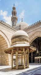 Ablution fountain at historic Sultan Barquq Mosque with dome and minaret in background, Cairo, Egypt