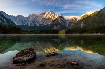 Wall Mural - magnificent landscape which consists of a panorama of mountain lake and mountains reflecting in a mirror of water of the lake
