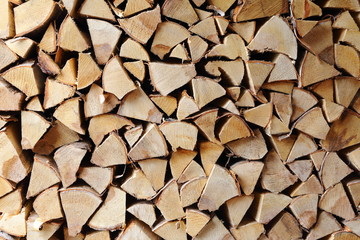 Tuinposter Brandhout textuur The wooden texture from birch firewood.