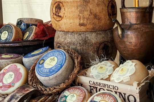 Wheels of hard cheese on the market stall.