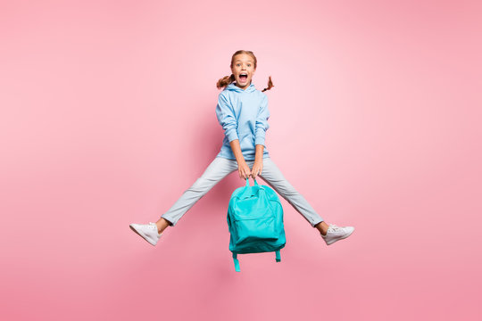 Summer. Full size photo of pretty little lady jumping high enjoy last studying day wear teal pupil backpack casual sweater clothes isolated pink color background