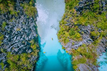 Aerial top down view of entrance into Big Lagoon at Miniloc Island, El Nido, Palawan, Philippines. Surreal karst limestone rocks