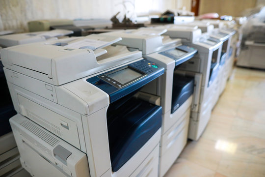 Shallow depth of field image with brand new multifunctional printers bought by a company
