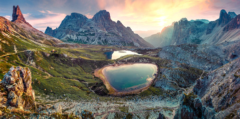 In de dag Landschap Impressive summer sunrise in rocky mountain valley. Fantastic morning scene of Tre Cime di Lavaredo National park with Laghi del Piani lakes, Dolomiti Alps, South Tyrol, Italy, Europe.