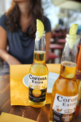 Drink at the bar with Corona Extra salt and lime.