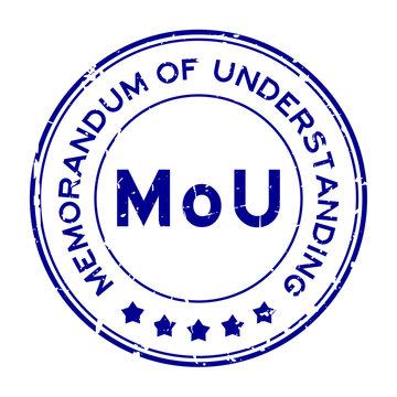 Grunge blue MOU (abbreviation of memorandum of understanding) word round rubber seal stamp on white background