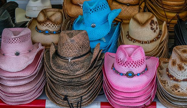 Stacks fo Colorful Cowgirl Hats at a County Fair