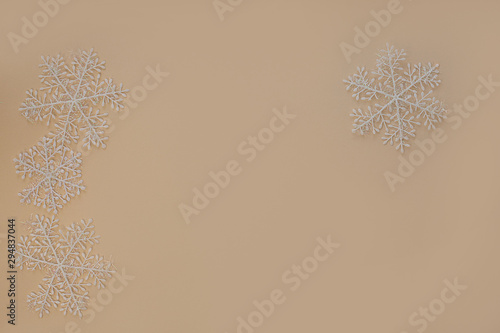 White Christmas Snowflakes On A Light Beige Background