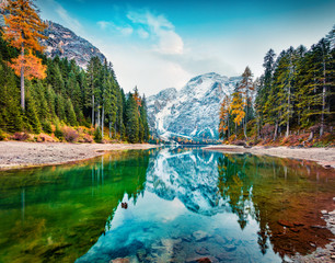 Stunning autumn view of Braies Lake. Incredible morning scene of Dolomiti Alps, Naturpark Fanes-Sennes-Prags, Italy, Europe. Beauty of nature concept background.