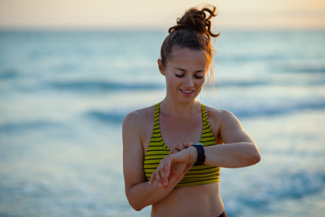 sports woman using smart watch