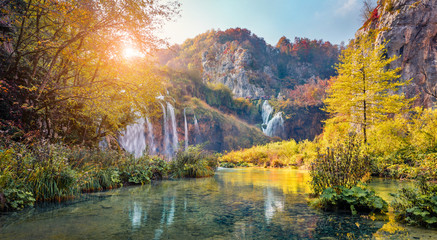 Attractive morning view of pure water waterfall in Plitvice National Park. Amazing autumn scene of Croatia, Europe. Abandoned places of Plitvice lakes series. Beauty of nature concept background.