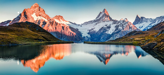 Tuinposter Alpen Fantastic evening panorama of Bachalp lake / Bachalpsee, Switzerland. Picturesque autumn sunset in Swiss alps, Grindelwald, Bernese Oberland, Europe. Beauty of nature concept background..