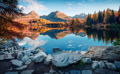 Attractive autumn view of Strbske pleso lake. Calm morning scene of High Tatras National Park, Slovakia, Europe. Beauty of nature concept background.