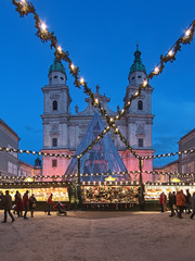 Salzburg, Austria. Christmas market at the Domplatz (Cathedral Square) in front of Salzburg Cathedral in twilight.