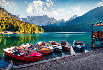 Poster Green blue Six pleasure boats on Fusine lake. Splendid morning scene of Julian Alps with Mangart peak on background, Province of Udine, Italy, Europe. Traveling concept background.