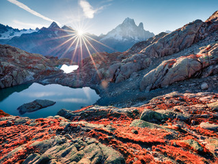Attractive autumn view of Lac Blanc lake with Mont Blanc (Monte Bianco) on background, Chamonix location. Unbelievable outdoor scene in Vallon de Berard Nature Preserve, Graian Alps, France, Europe.