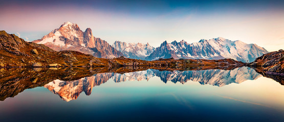 Panoramic autumn view of Cheserys lake with Mount Blank on background, Chamonix location. Magnificent outdoor scene of Vallon de Berard Nature Preserve, Alps, France, Europe.