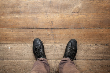 Male feet in shiny black leather shoes