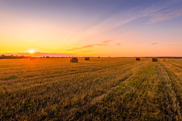 Scene of sunset on the field with haystacks in Autumn sunny evening. Fototapete