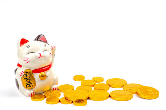 Lucky cat statue for Japanese isolated on a white background, Holds a gold medal in Japanese that translates into prosperity and good fortune.