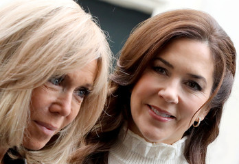 French first lady Brigitte Macron arrives with Danish Crown Princess Mary during a visit at the high school Lamartine, in Paris