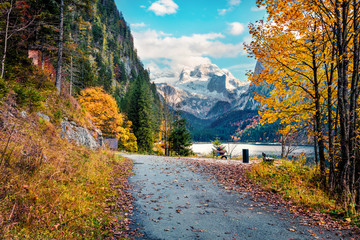 Captivating autumn scene of Vorderer / Gosausee lake with Dachstein glacieron background. Stunning morning view of Austrian Alps, Upper Austria, Europe. Traveling concept background.