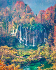 Epic morning view of pure water waterfall in Plitvice National Park. Aerial autumn scene of Croatia, Europe. Abandoned places of Plitvice lakes series. Beauty of nature concept background.