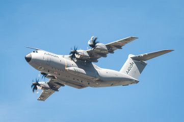 Airbus A400M military transporter in low-level flight over Farnborough, UK on July 18, 2014