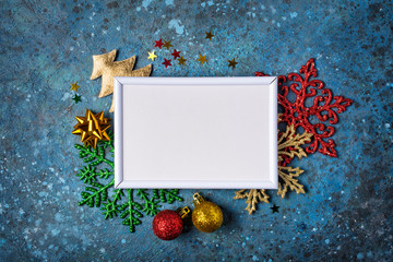 Mockup of photo frame and colored christmas decorations