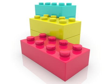 Colorful toy brick building on a white background