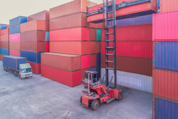 Fototapete - Industrial port crane lift up loading export containers box onboard from truck at port of Thailand,The port crane type's twin lift is the best solution for port operations