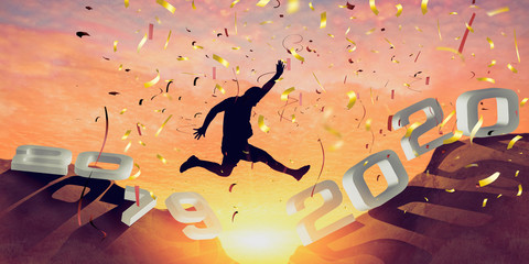 Silhouette of young  man jumping from the cliff that has the year number 2019 to the side that has the year number 2020 with sun rise background, Concept for Happy new year 2020. - Image