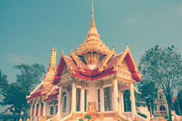 Wall Mural - Buddhist temple in Kanchanaburi, Thailand. Retro filtered colors style.